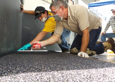 Polylast Crew Members Intalling Trailer Flooring